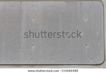 Metallic Texture. Metal Surface with some screws in it - stock photo
