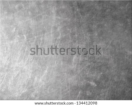 Metallic texture with grunge scratches - stock photo