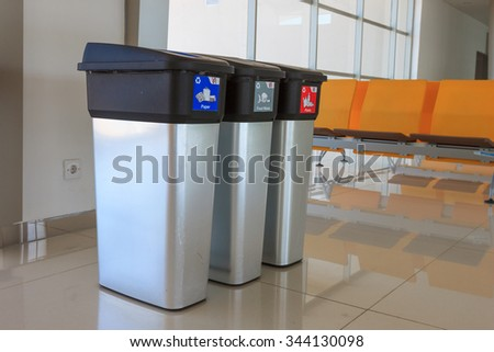 Metallic Trash Bin at terminal airport - stock photo