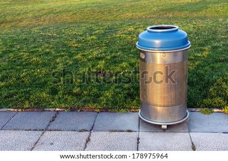 metallic trash bin on park - stock photo