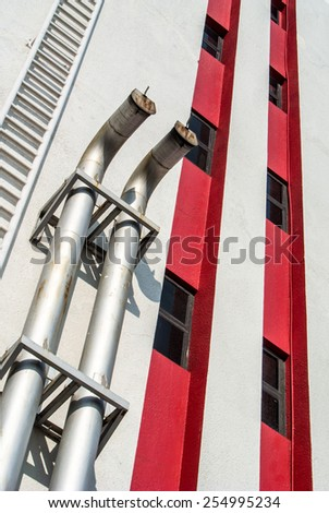 Metallic tube for air ventilation on industrial building. - stock photo