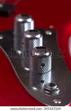 Metallic volume bass treble guitar bas knobs. - stock photo