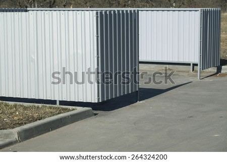 Metalloprofil fenced area for containers with garbage in the yard