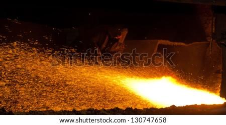 metallurgic production, production of cast iron, metal melting - stock photo