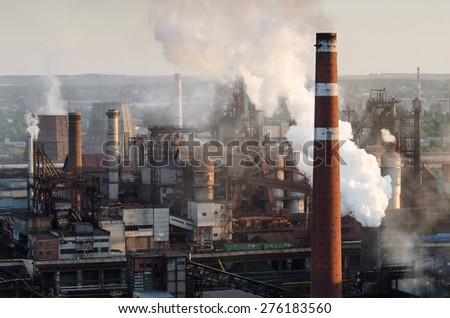 Metallurgical plant at sunset - stock photo
