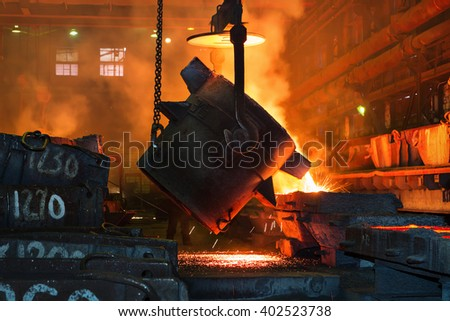Metallurgical plant, hot metal casting. - stock photo