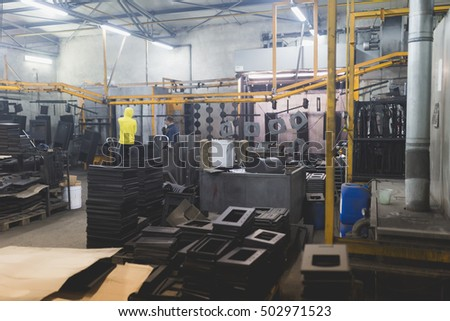 Metallurgy industry interiors. Details from factory for production of boiler stoves.