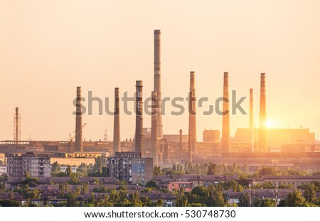 Metallurgy plant at sunset. Steel mill. Heavy industry factory. Steel factory with smog. Pipes with smoke. Metallurgical plant in city. steel, iron works. Ecology problems, atmospheric pollutants