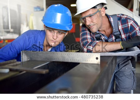 Metalwork student girl training in workshop