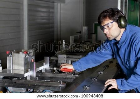 Metalworker working in fabric - stock photo