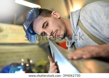 Metalworker working in workshop