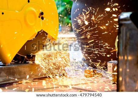 Metalworking / close up of cutting metal, Industrial Worker