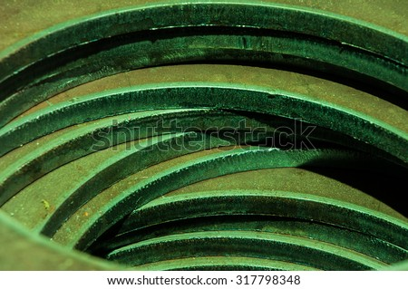 Metalworking industry. cutting tool processing steel metal spiral pinion. Focus on spot. - stock photo
