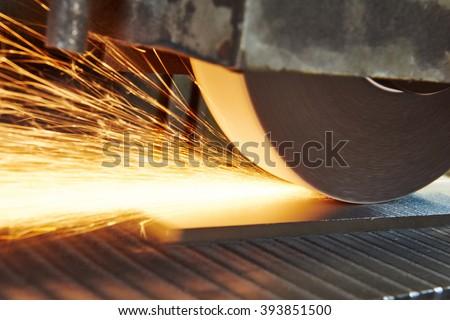 metalworking industry. finishing metal surface on horizontal grinder machine  - stock photo