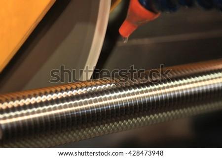 metalworking industry: finishing metal working threading on lathe grinder machine - stock photo