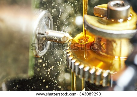 metalworking industry. tooth gear cogwheel machining by cutting mill tool.  - stock photo