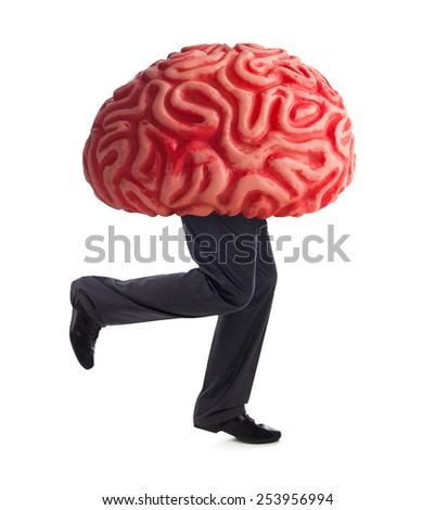 Metaphor of the brain drain. Rubber brain legs while running on white background. - stock photo