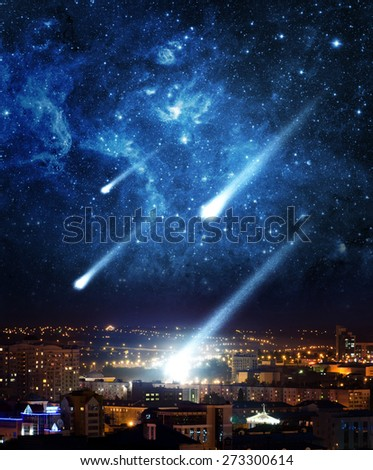 Meteor shower destroying city on earth. Elements of this image furnished by NASA. - stock photo