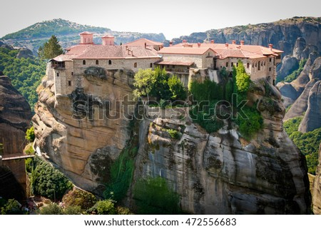 METEORA, GREECE - JUNE 28, 2015: The beautiful and impressive Holy Monastery of Varlaam stands proud on a large rock in Meteora - northern Greece. This monestary was first occupied in the 14th century