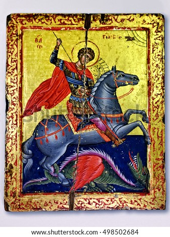 Meteora, Greece - Sept 27, 2016: Ancient orthodox wooden icon Saint George Victorious killing the dragon on the wall in the Holy Monastery of Saint Stephen, Meteora, Greece. Circa 17th century