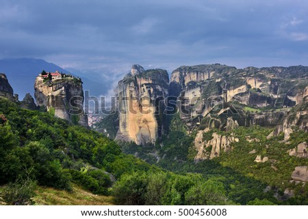 Meteora monasteries. Beautiful view on Monastery of the Holy Trinity placed on the edge of high rock at sun rises, Kastraki, Greece