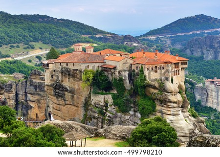 Meteora monasteries. Beautiful view on the Holy Monastery of Varlaam placed on the edge of high rock at sunset, Kastraki, Greece