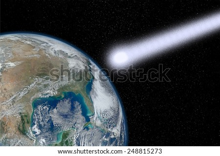 Meteorite close to collide with the Earth as a concept of the end of the world. Elements of this image furnished by NASA