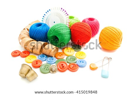 meter, pins, buttons and thread on white - stock photo