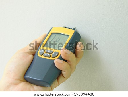 metering moisture in wall painting - stock photo