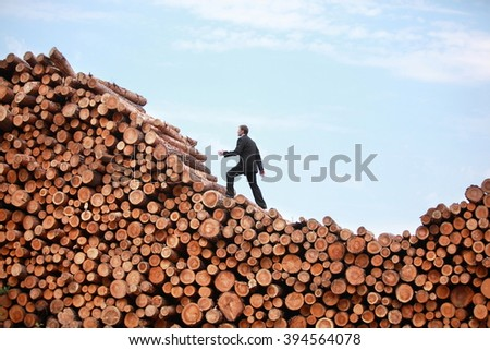 Methodical Business Man on his way to the top  -  end of recession  - stock photo