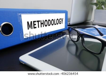 METHODOLOGY CONTEPT Office folder on Desktop on table with Office Supplies. ipad - stock photo