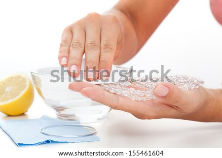 Methods of cleaning jewellery - lemon juice and a water - stock photo