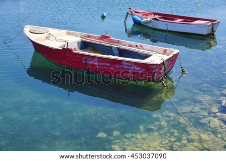 METHONI, GREECE -10 JULY 2016- Small fishing boats in the Methoni harbor in the Messenia region of Peloponnese in Greece.