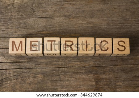 METRICS text on a wooden background - stock photo