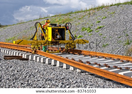 Metro construction site, railroad track installation machine is in use