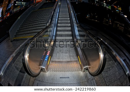 Metro moving escalator with no people - stock photo