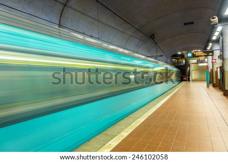 metro station with blurred arriving train - stock photo