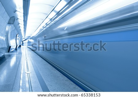 metro station with train in motion - stock photo