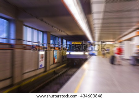 metro train passing by in  subway station