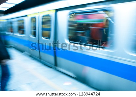 metro train travels at high speed through a train station , concept for time,  shot in Taipei, Taiwan, asia - stock photo