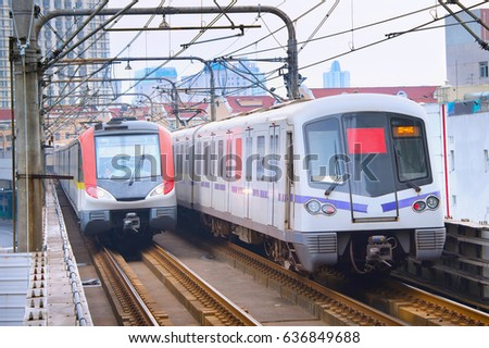 Metro trains on a rails in Shanghai in the day. China