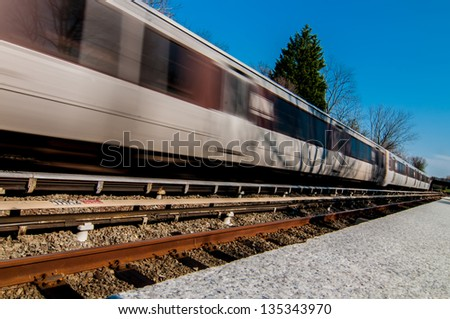 Metro unit leaves station - stock photo