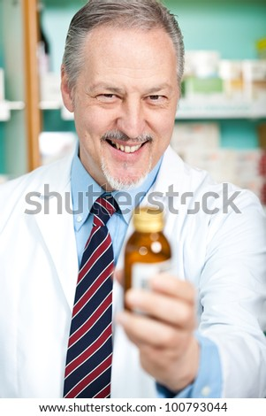 Meture chemist suggesting a medicine - stock photo