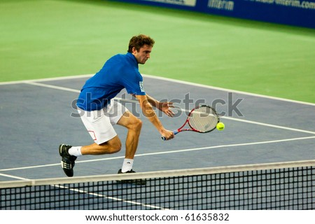 METZ, FRANCE - SEPTEMBER 23: Gilles Simon (FRA, ATP No. 41) defeats Igor Sijsling (The Netherlands, not pictured) in the 1/8 finals of the ATP Open de Moselle on September 23, 2010 in Metz. - stock photo