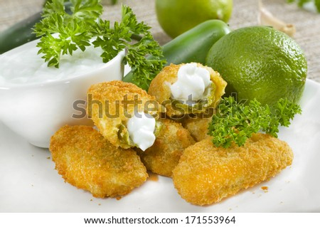 Mexican-american jalapeno poppers served with lime . - stock photo