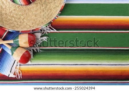 Mexican background, sombrero, blanket, maracas.   - stock photo