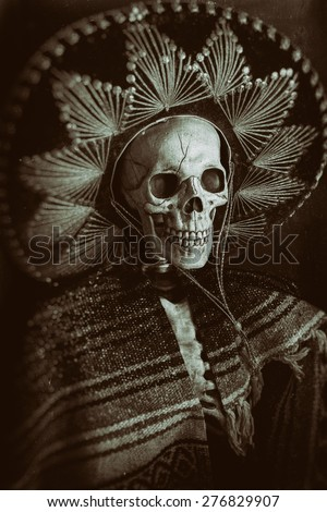 Mexican Bandit Skeleton 8. A skeleton wearing a Mexican sombrero and a poncho. Edited in a vintage film style.
