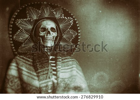 Mexican Bandit Skeleton 2. A skeleton wearing a Mexican sombrero and a poncho. Edited in a vintage film style. - stock photo