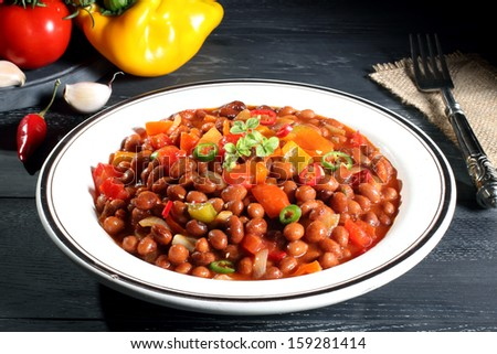 mexican beans chili gray background - stock photo