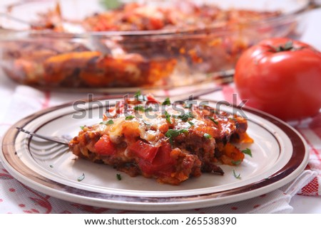 Mexican beef tortilla lasagna with tomato - stock photo